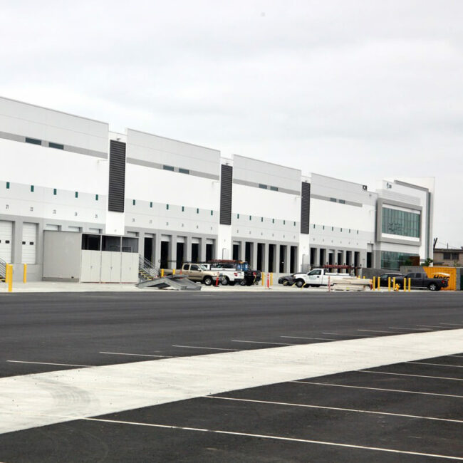 Exterior of distribution warehouse with dozens of delivery bays.