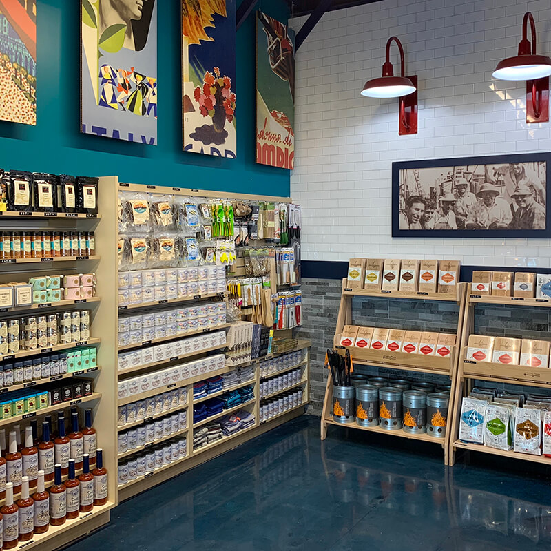 Colorful store interior with shelves of specialty condiments, canned items, and beautifully packaged food products.